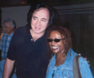 Tom Sadge with Julia Waters of Neil Diamond band.