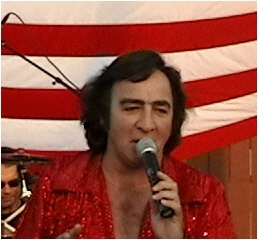 Neil Diamond impersonator performs America with his tribute band.