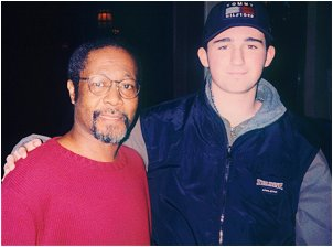 Tom Sadge's son Fred with Neil Diamond percussionist Vince Charles.